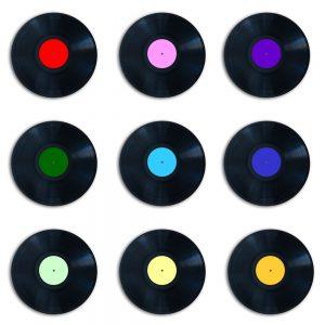 Six multicolored vinyl records