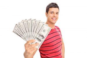 Man holding up money