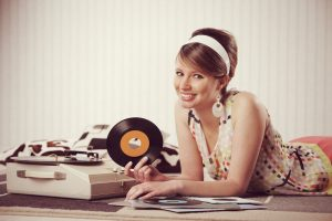 Vintage-looking woman surrounded by vinyl records